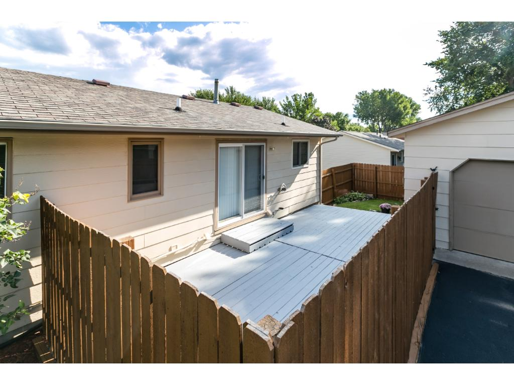 Very large deck with privacy fence.