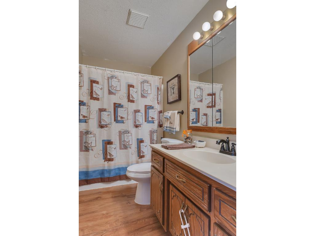 Here we have the main level full bath with a large vanity with cabinets and drawers for storing all kinds of bathroom items.