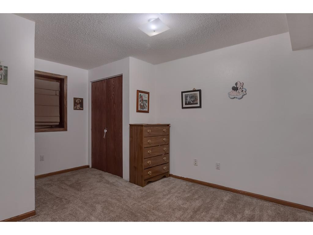 Lastly is the 5th bedroom.  There is a laundry room on this lower level too that's set up with a clothes chute for the main level bedrooms.