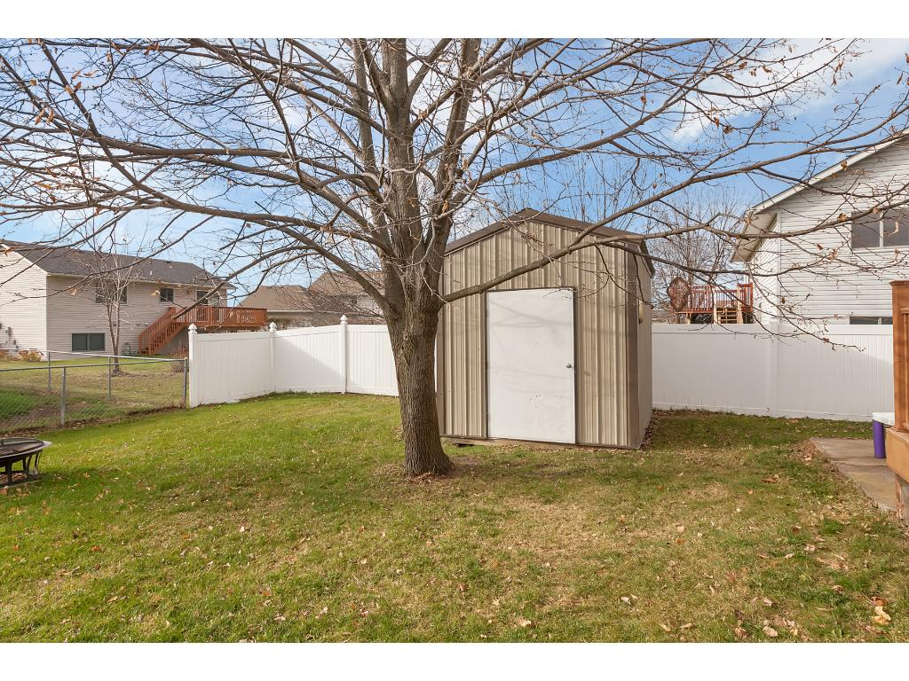 The backyard is totally fenced in and includes a storage shed for yard tools.