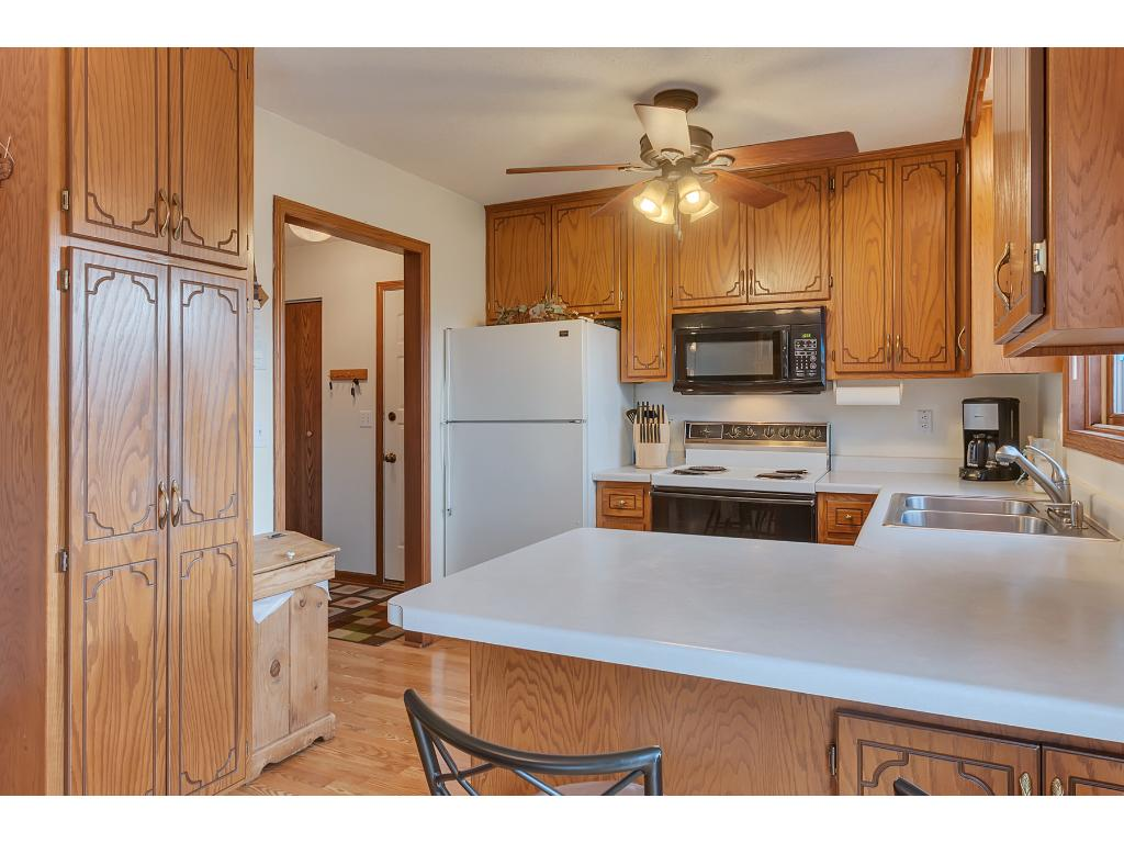 The kitchen features a ceiling fan, window above sink and a new 2016 dishwasher.