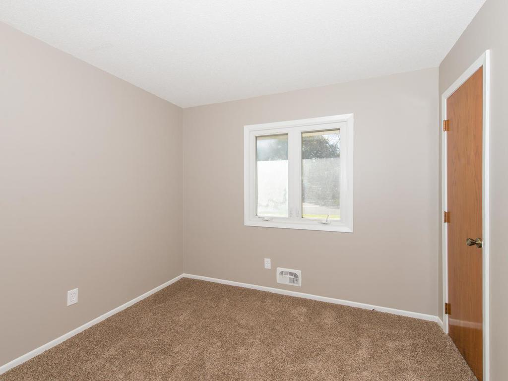 Main level Bedroom with carpeting.