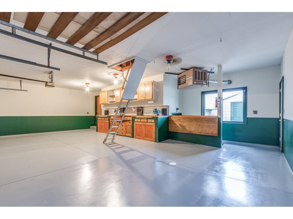 Featuring; Custom Cabinets, Epoxy Floors, Heated U0026 Insulated, Above Garage  Lighted Storage