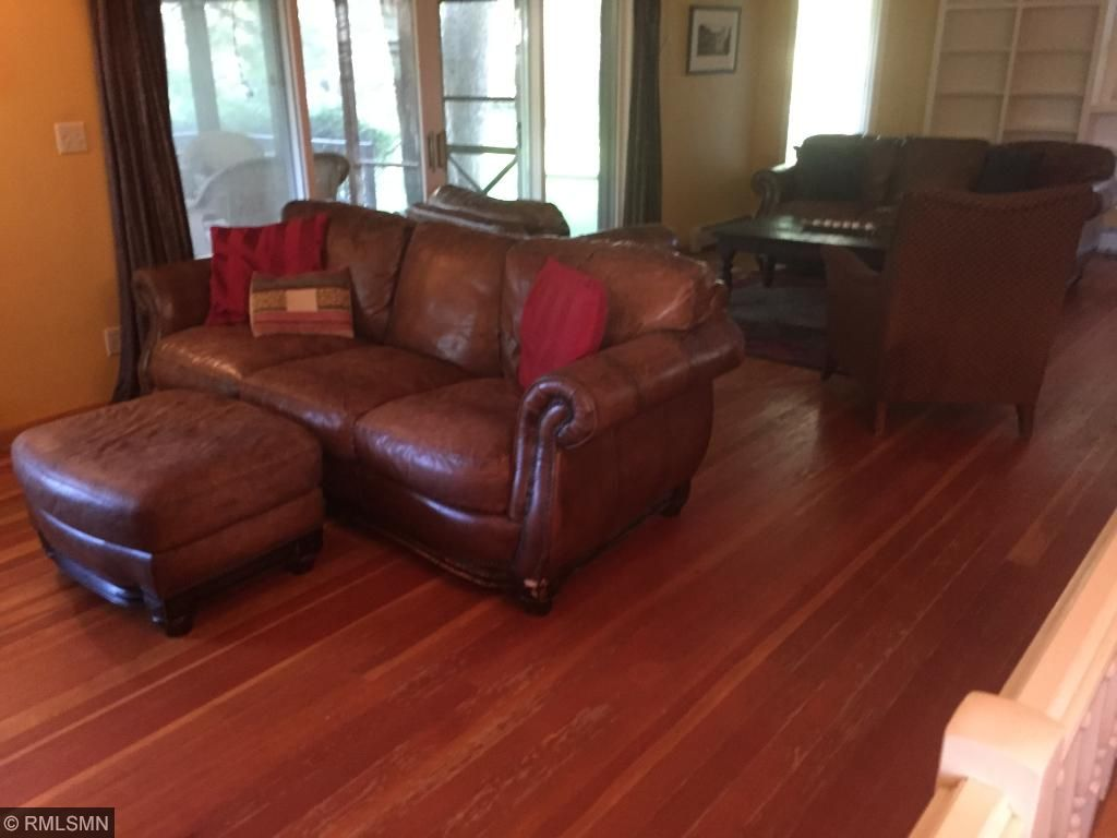 huge main level family room with hardwood floors