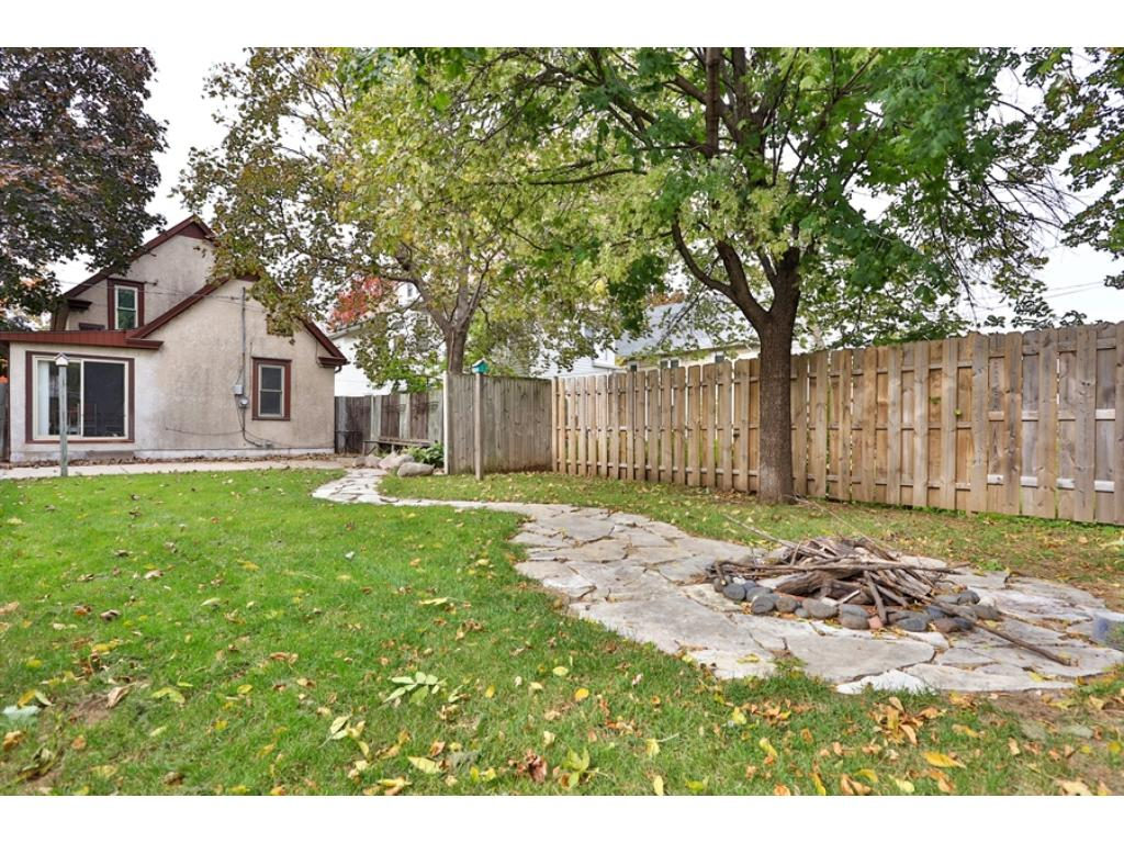 Situated on a 140 foot lot, the back yard is very spacious - there's even room for a fire pit.