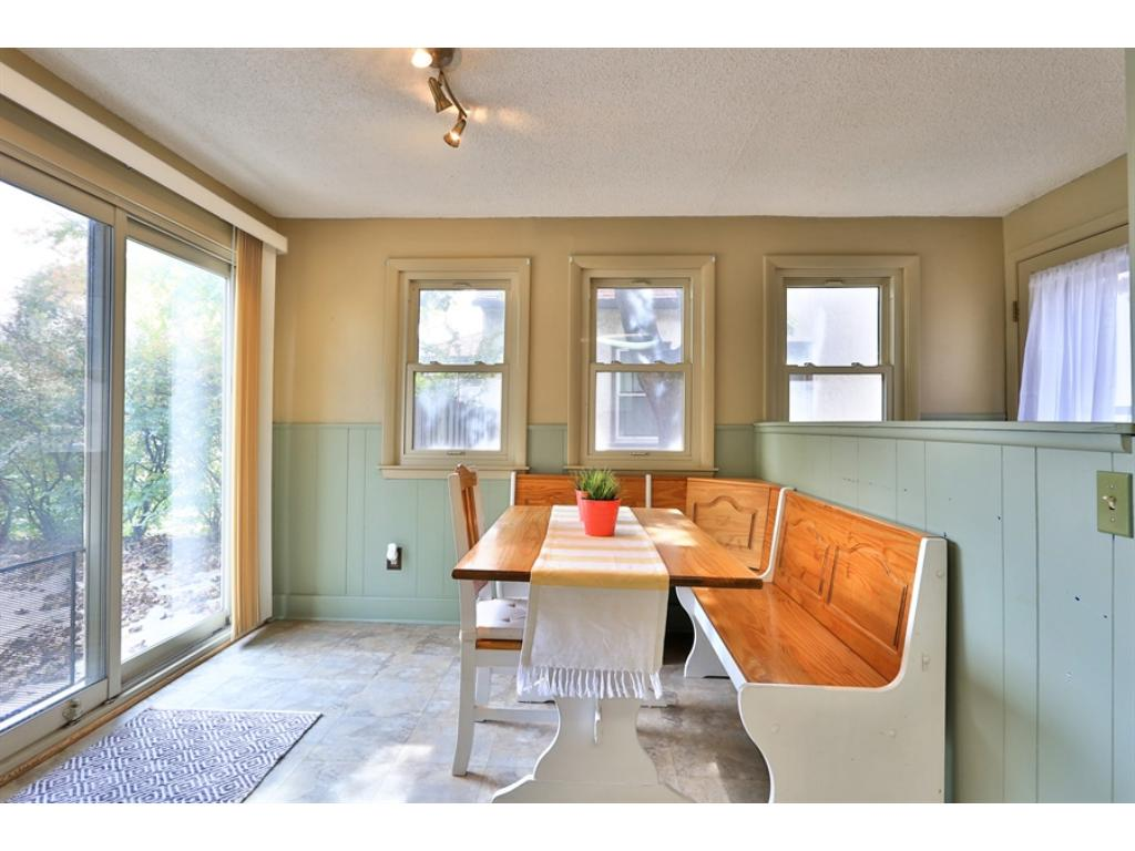 The eat-in kitchen opens out to the back yard.