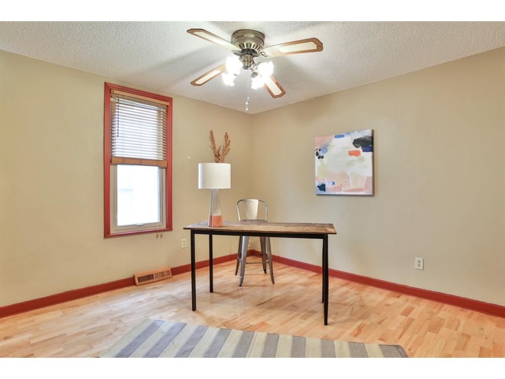 The house has 3 bedrooms. This bedroom on the main floor can be easily used as an office or den, too.