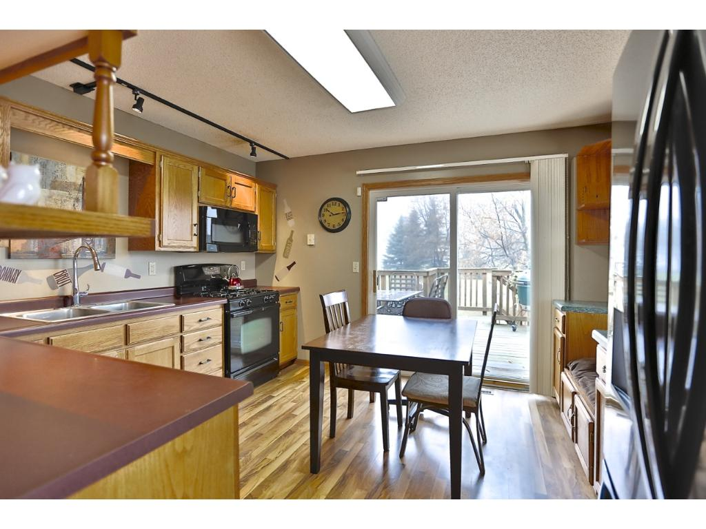 There is an abundance of cabinet space in the kitchen. Dine here, or head out the patio door and dine el fresco on the deck overlooking your backyard.