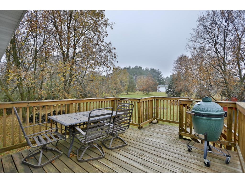 Backyard deck; the perfect place to enjoy the yard and a beverage.