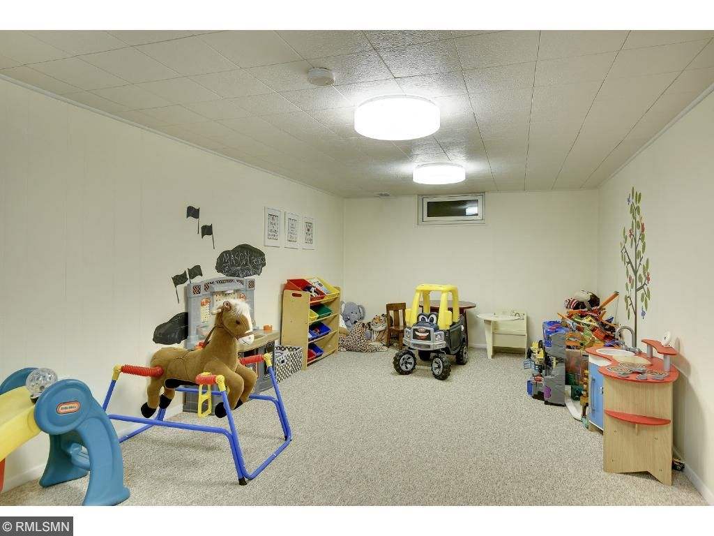 This end of Lower Level Family Room is being used as a play room.