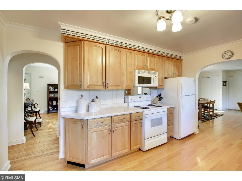 Kitchen is the center of the home.  There are hardwood floors throughout the main level.  Gorgeous!