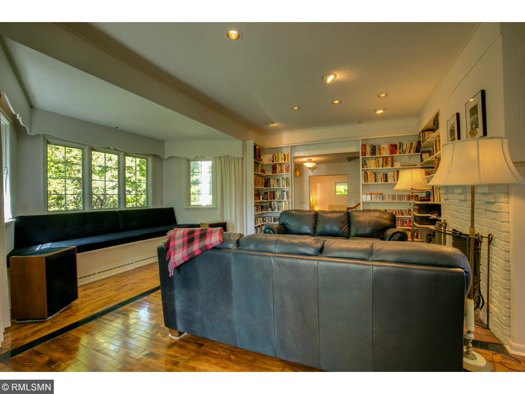 Living room has large bay window with bench seat that extends the length of the windows.
