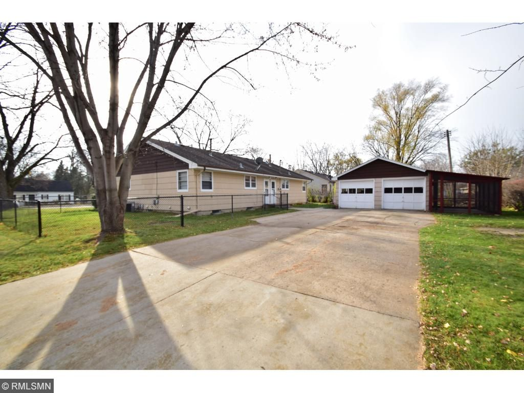 HUGE Concrete Driveway PLUS Separate Garage Stalls and BONUS Screened Porch that Can be Used for Additional Parking!
