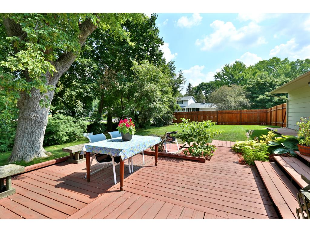Dig the deck and cool contemporary feel of this back yard.  Private, spacious, gardens, nice patio and fire pit area, and VERY private.