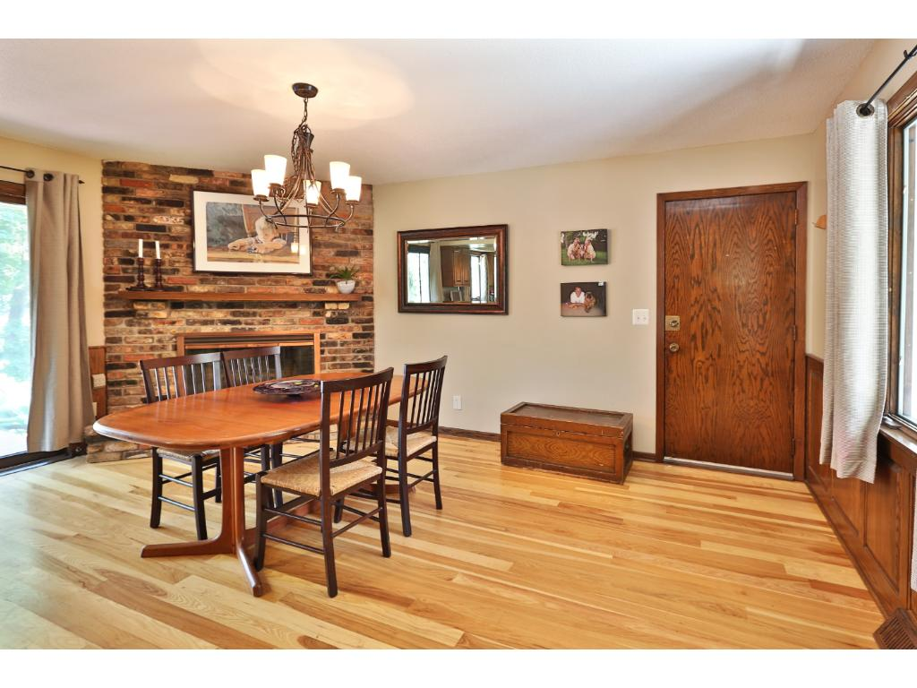 Two car attached garage opens into the large and spacious kitchen - slider doors go out to a great deck & patio.
