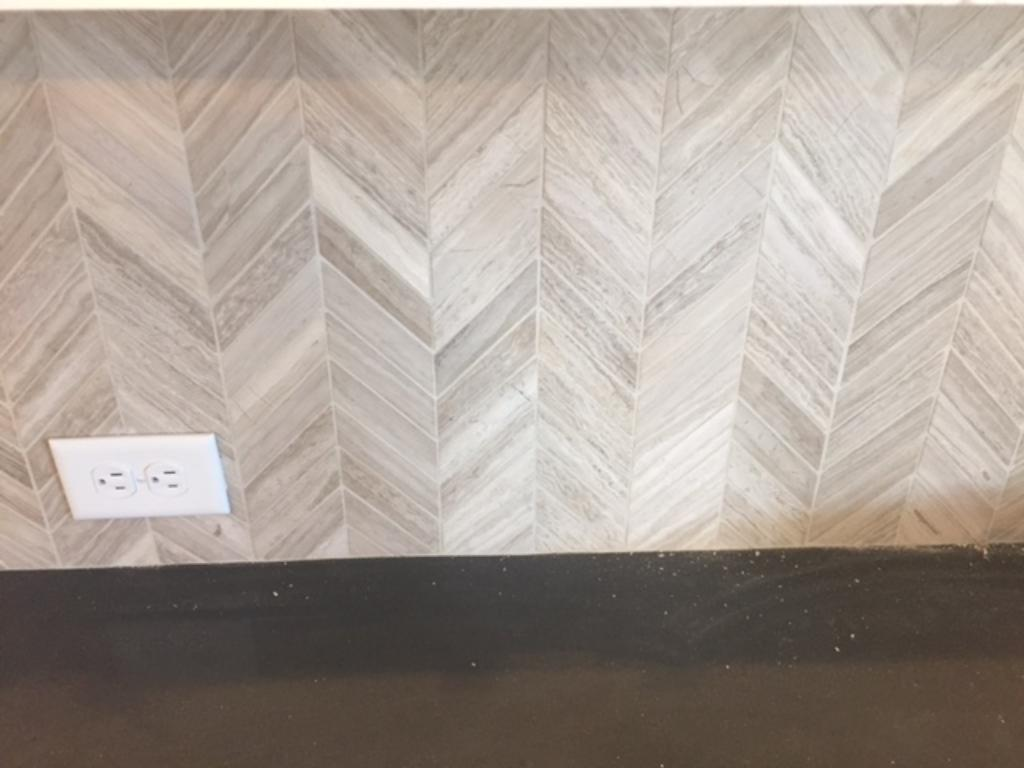 A herringbone tile pattern is sure to wow your guests.