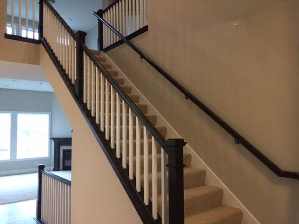 Beautiful railing as you enter the home