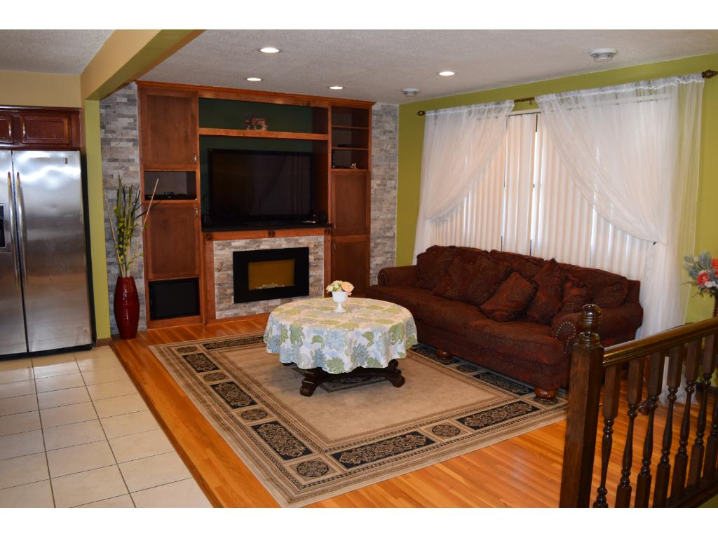 Great Room with new entertainment center and fireplace.
