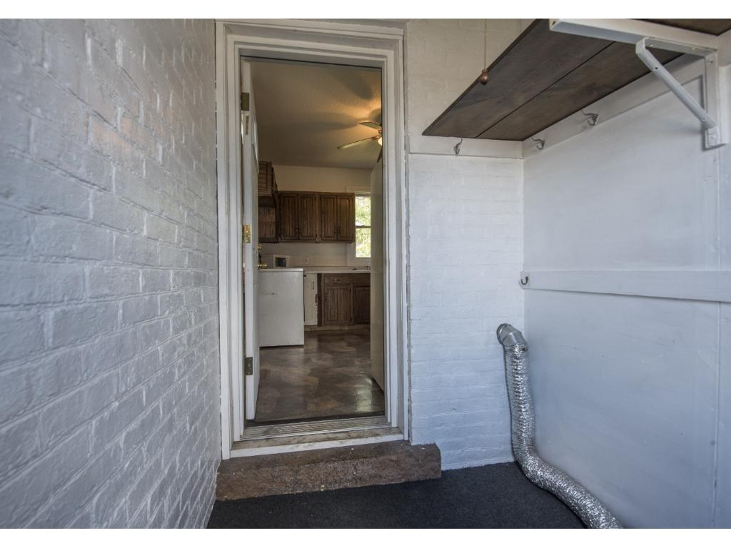Large entry into the back of the house.  Great area to collect shoes, jackets or turn into the laundry area.