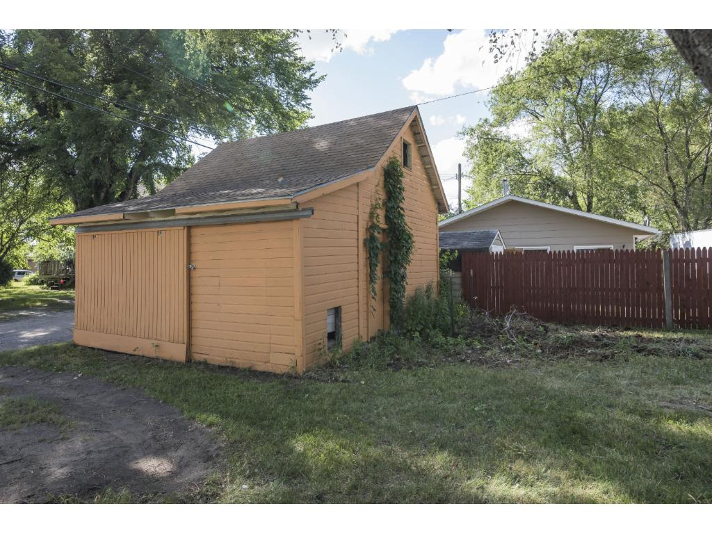 One stall garage/storage shed.  Extra storage in built in upper level loft with stairway.  Attached massive dog house or additional storage area.