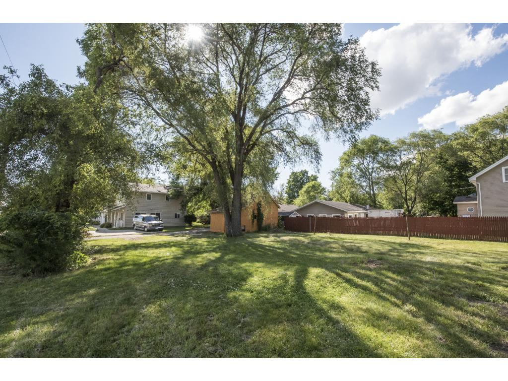 Large double lot with privacy fence between yards.