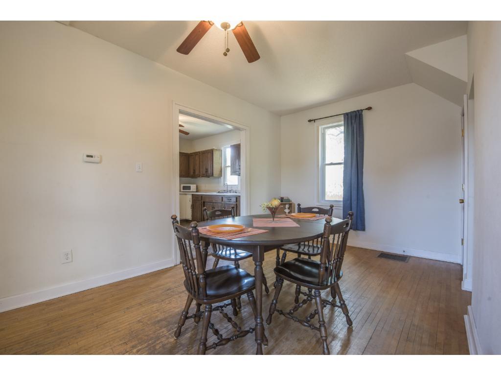 Large dinning area with original hardwood floors.