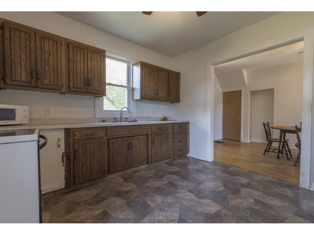 New flooring in kitchen with large entry from dinning to kitchen area.