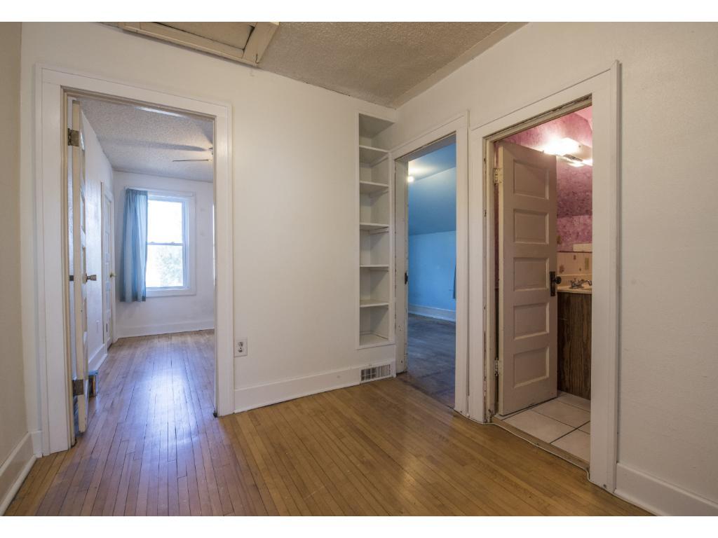 Large upstairs landing!  Original hardwood flooring through out upper level.