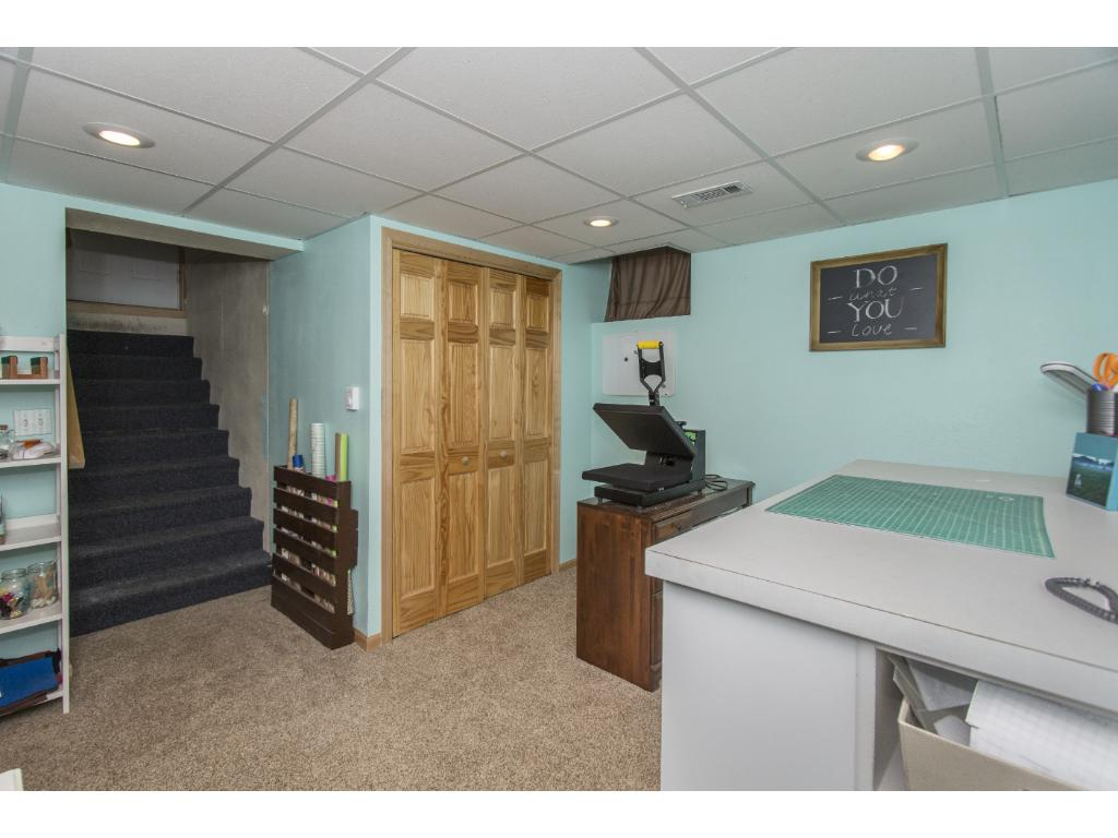 Lower level craft room or office with access to the garage