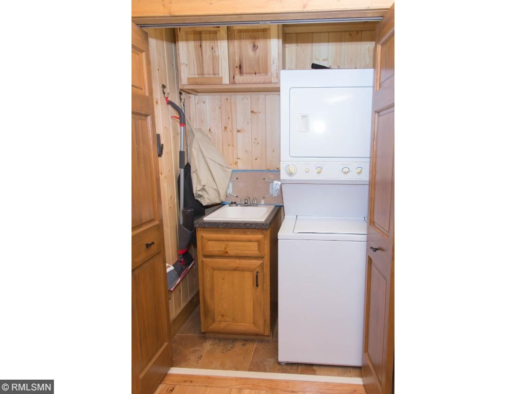 Washer & dryer tucked into a closet.