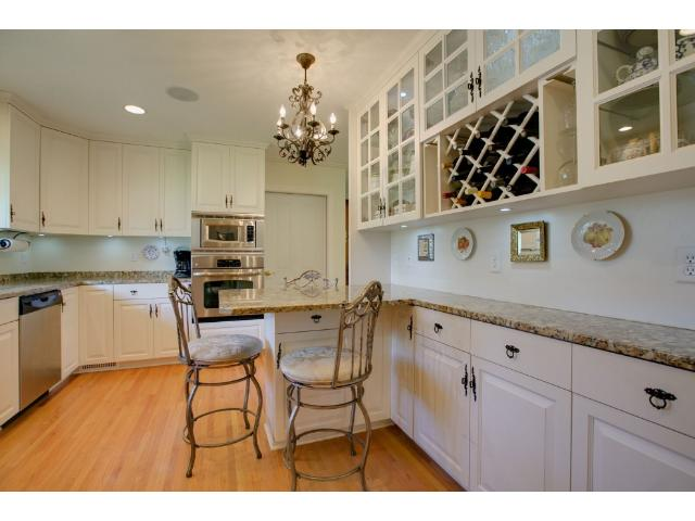 Back wall cabinetry in kitchen and wine rack.  Breakfast bar bump out seats three!
