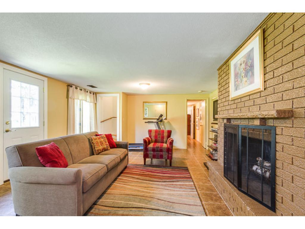 Lower level family room with wood burning fireplace and walkout to huge backyard!  Bedroom #4 and office space with a ton of storage options.