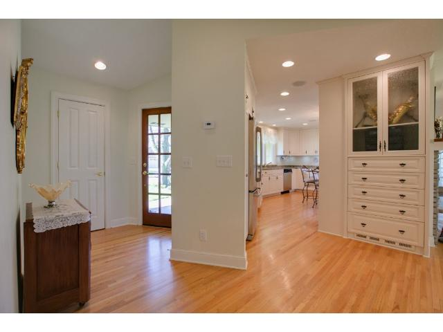 Front entry and foyer with excellent access to remodeled eat-in kitchen!  Kitchen is decked out in granite and has a wonderful breakfast bar for on the go needs!