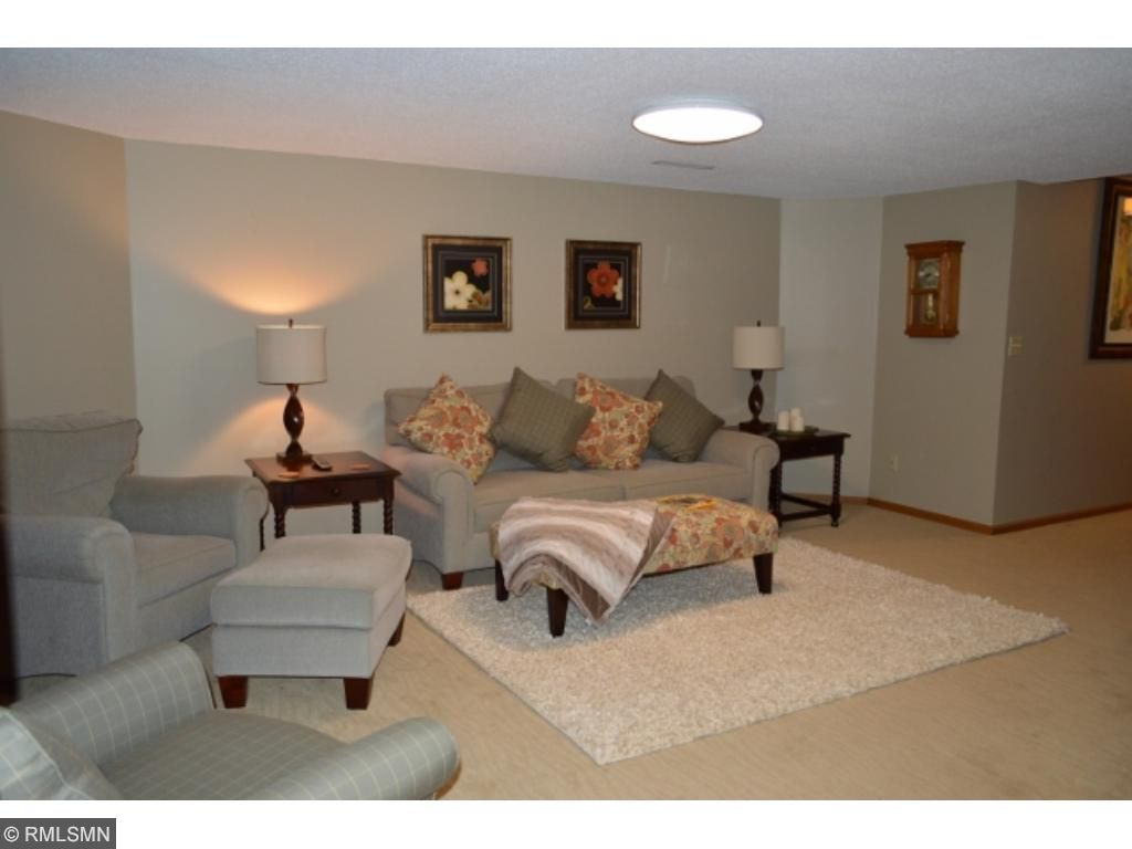 Comfortable lower level family room complete w/ gas FP!