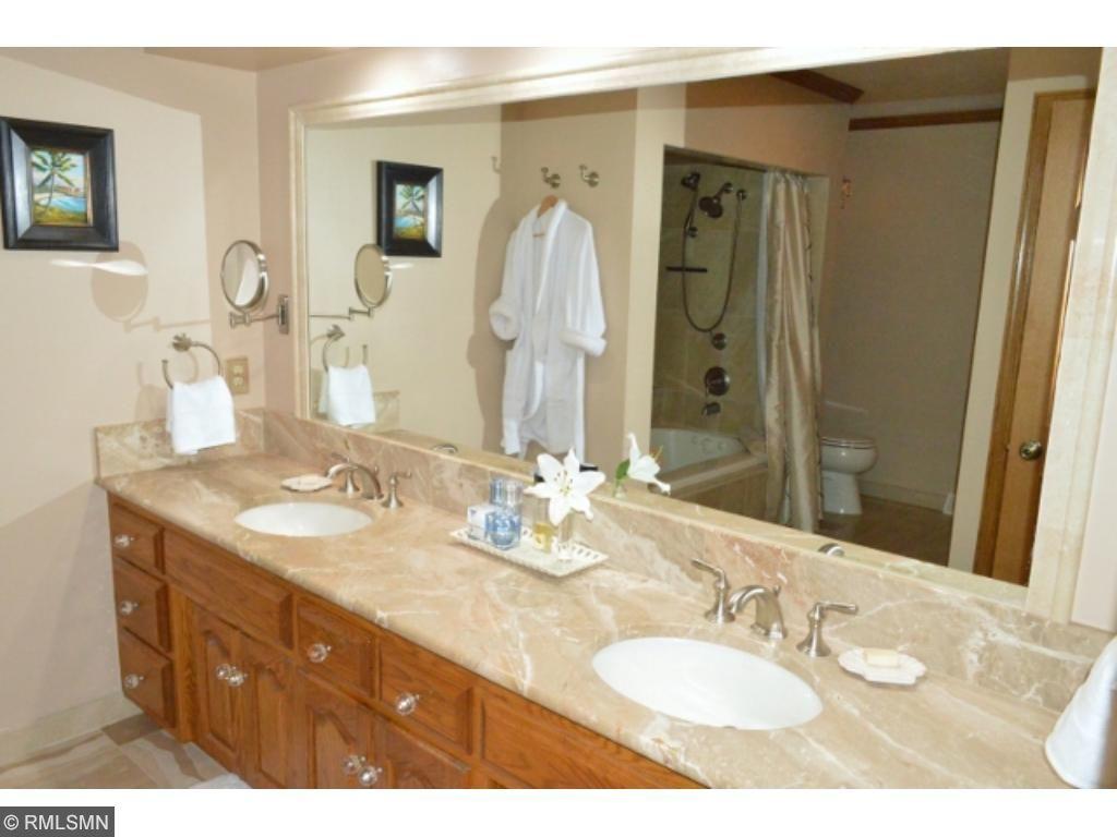 Incredible bath w/ in floor heat, double vanity, custom tile, whirlpool tub!!