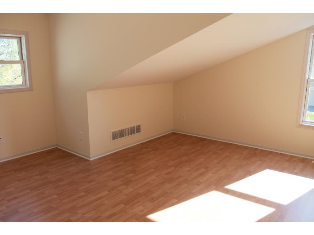 Upper level Bonus room/Bedroom with an attached 1/2 Bath.