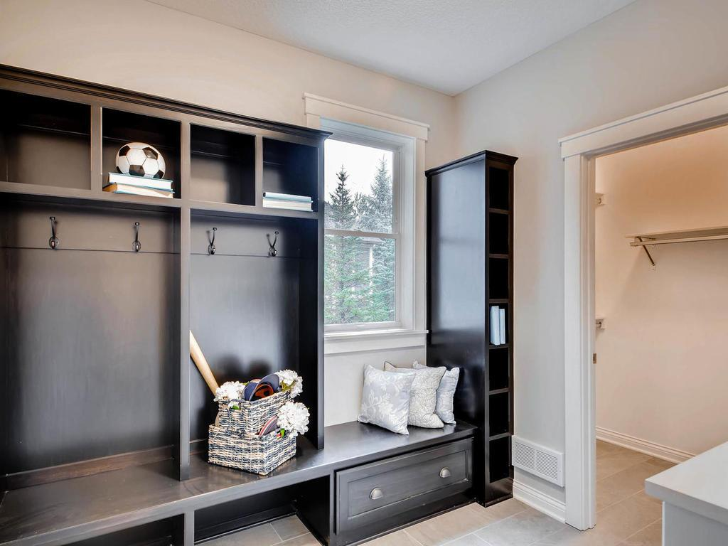 Spacious mudroom with benches