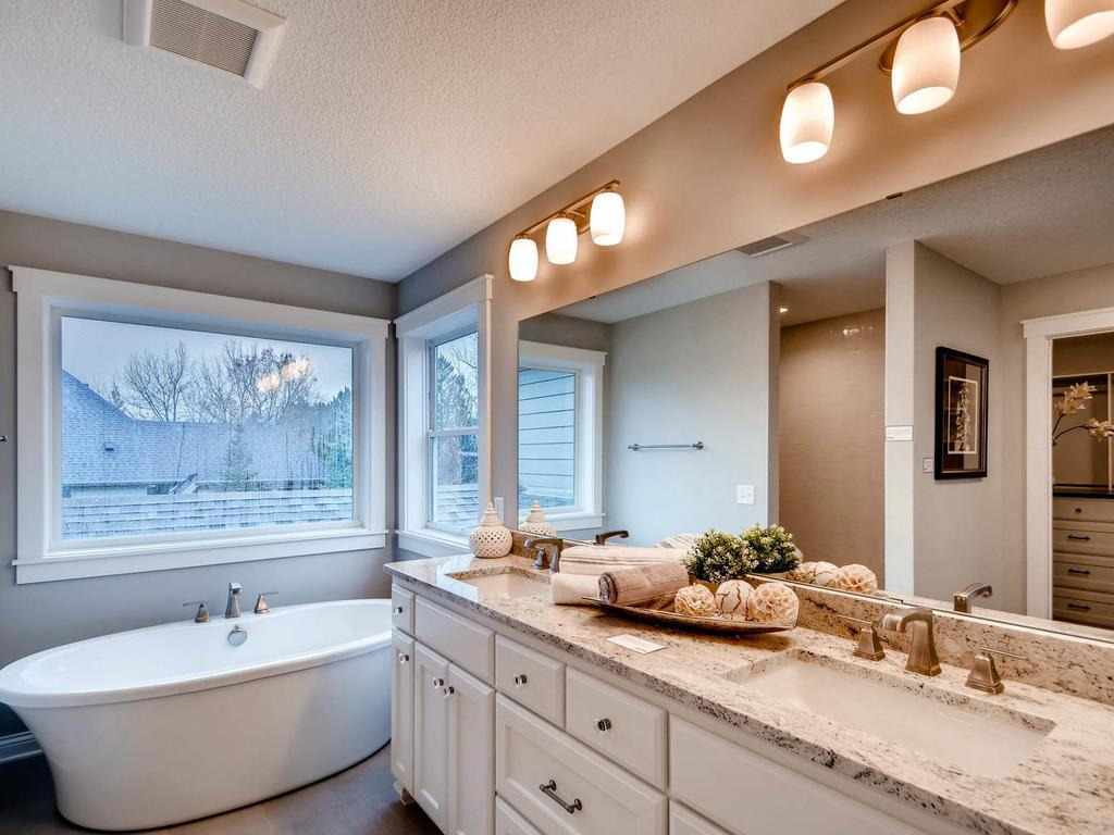 """Dreamy owner""""s bathroom with stand alone soaking tub, dual vanities and heated floor"""
