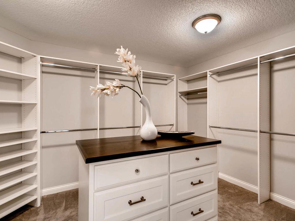Brick/Stone,Wood & ShakesSolid wood paneled interior doors & center Island in Master bedroom closet