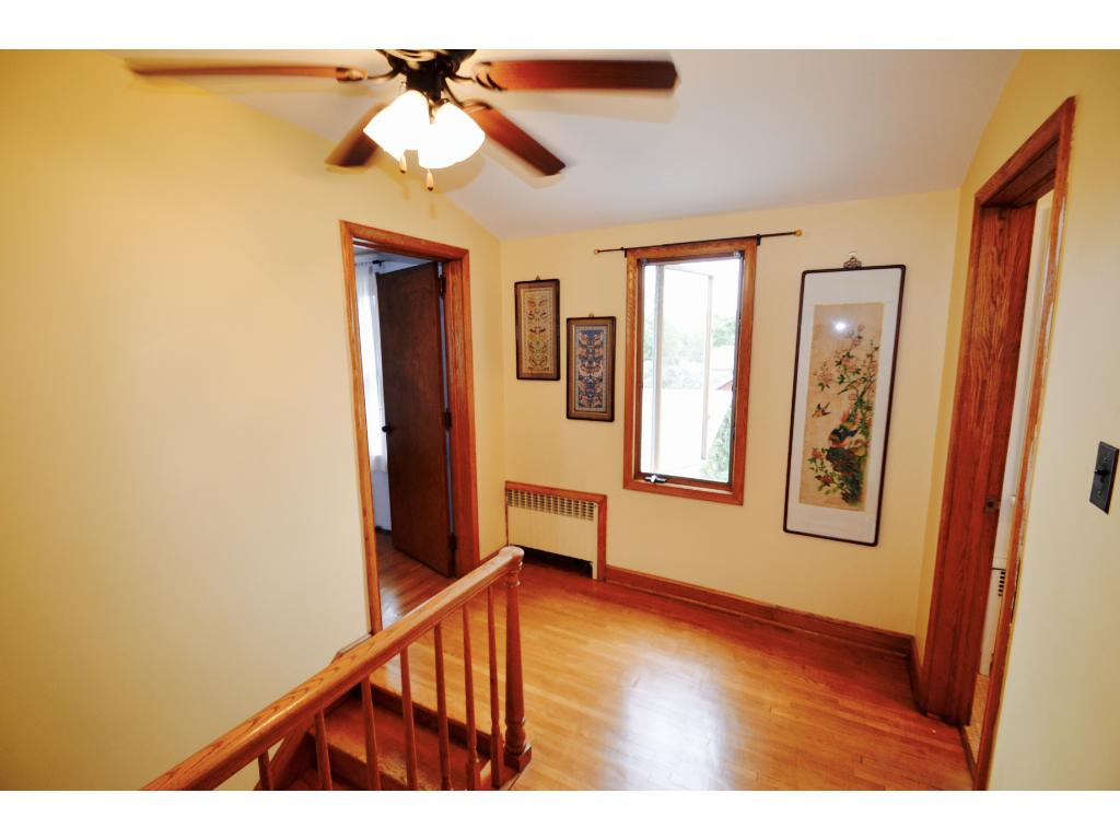 As you walk up the stairs, the landing provides ample space.