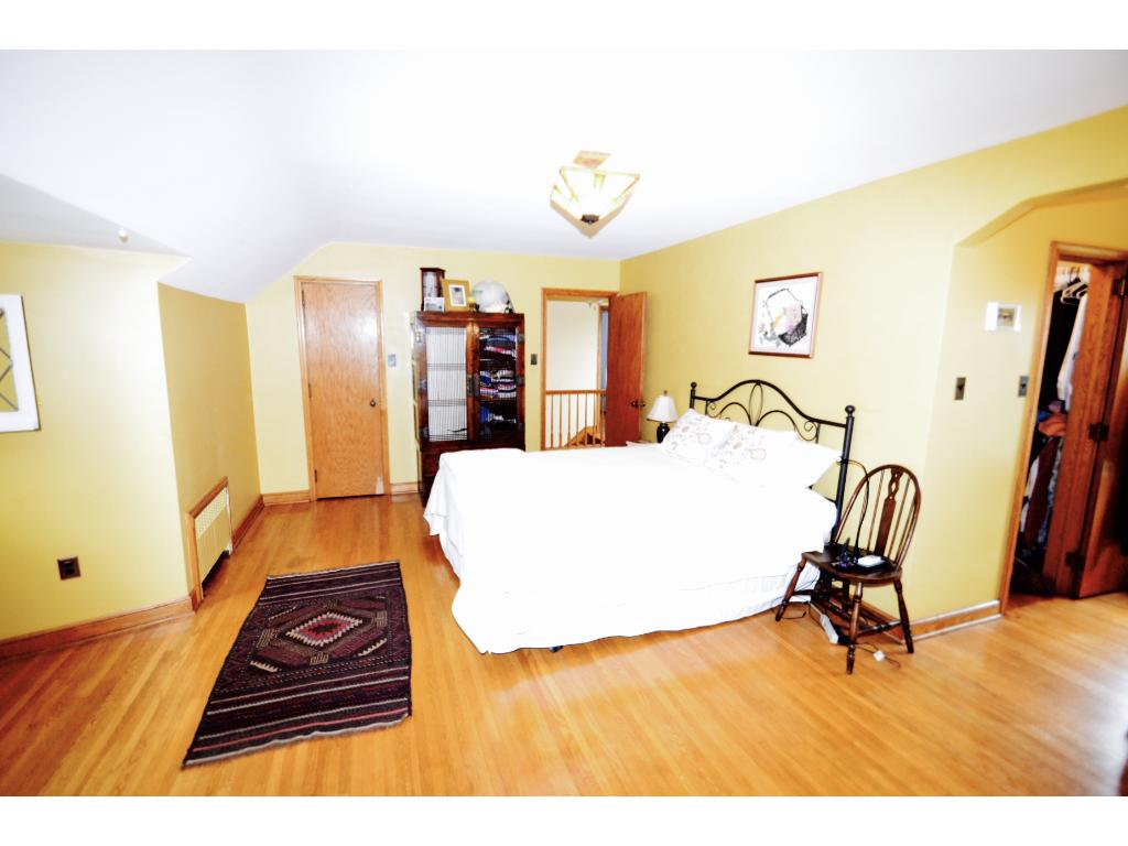 The Master Bedroom features original hardwood floors, space for even the largest bedroom furniture and a walk in closet.
