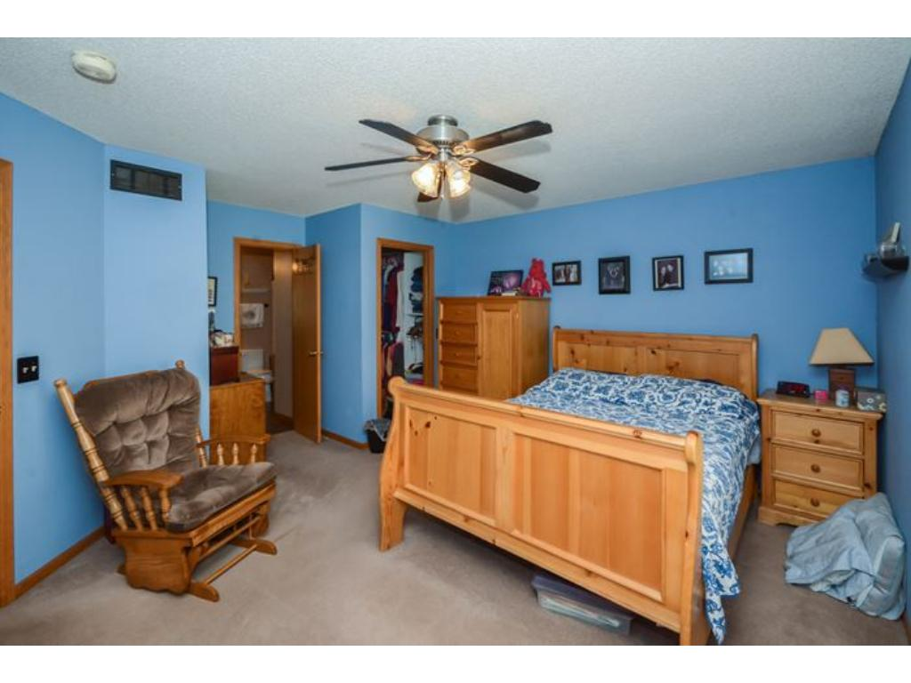 Good sized Master Bedroom on upper level with walkthrough to full bath.