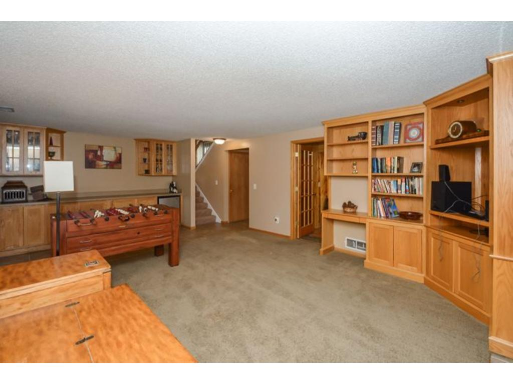 The lower level Family Room is where you'll want to spend your leisure time.  Beautiful built in cabinetry and shelving.