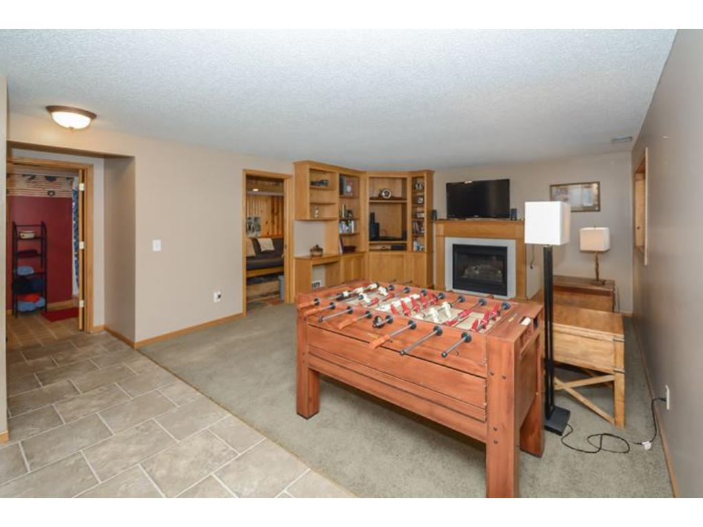 Another view of the lower level Family Room highlighting the pretty fireplace with tile and Oak surround and mantel.