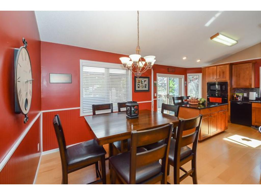 Remodeled dream Kitchen with upscale cabinetry, granite countertops, wood floor, and quality appliances.