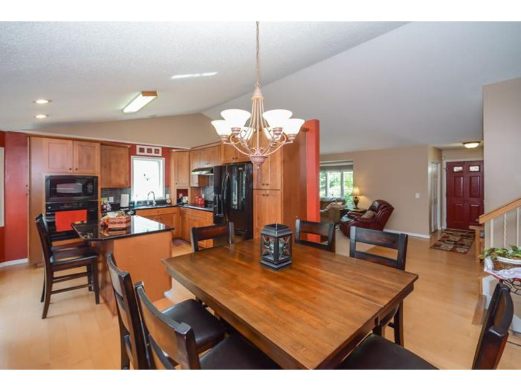 View into kitchen and living room on main level.  Note the granite topped kitchen island.