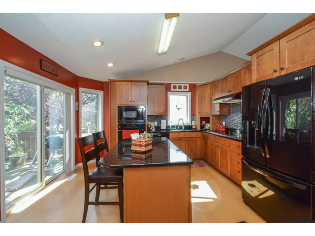 Another view of the bright sunny Kitchen and sliding door to deck.