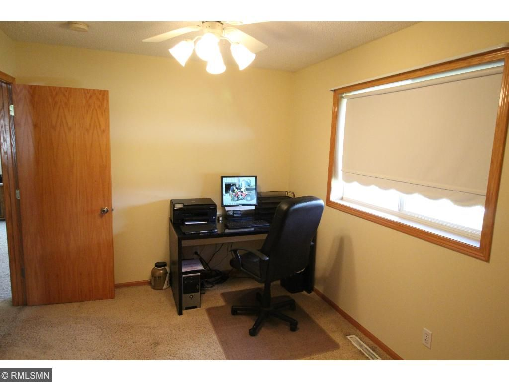 One of the main-floor bedrooms is serving as an office.
