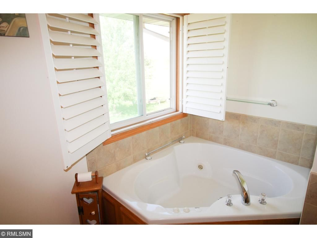 Master bath offers Jacuzzi bath, walk-in closet and double sink.