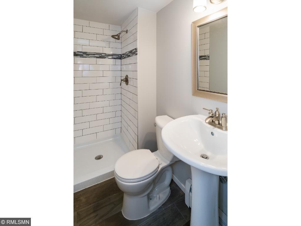 Newly tiled en suite bathroom.